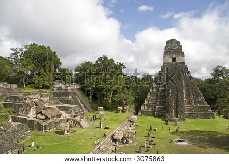 Jaguar Pyramid and other ruins at cloudy sky - stock photo