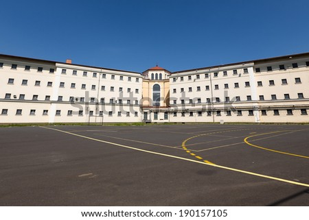 jail building, soccer field - stock photo