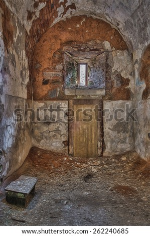 Jail Cell in Eastern State Penitentiary with Door Leading to the Exercise Yard, Philadelphia, Pennsylvania - stock photo