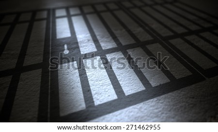 Jail cells bars casting shadows on the prison floor. - stock photo