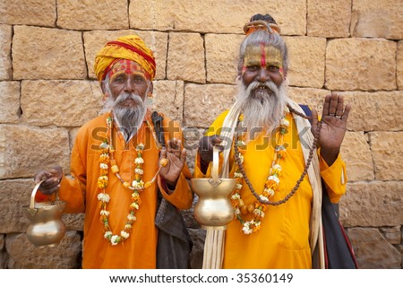 jain priest welcoming saluting in jaisalmer in rajasthan state in india - stock photo