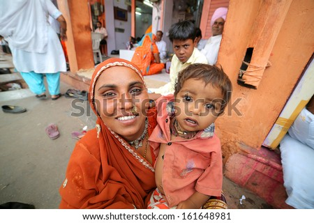 JAIPUR, INDIA - APRIL, 2013: portrait of an Indian mother and child - stock photo
