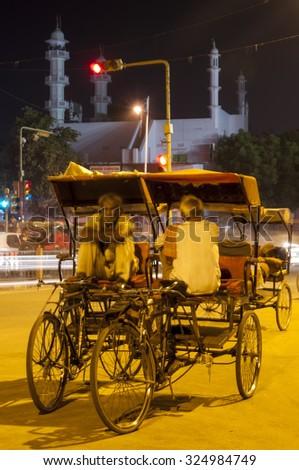 Jaipur, India - August 14, 2015: Rickshaw drivers relaxing in Jaipur on August 14th in Jaipur, India - stock photo