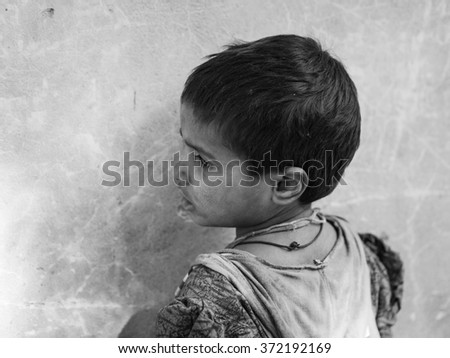 jaipur, India - Circa December 2015 - young homeless girl in india - stock photo