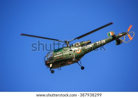JAIPUR, INDIA - FEBRUARY 28: Military helicopter flying in blue sky on February 28, 2011 in Jaipur, India. The Army Aviation Corps is a component of the Indian Army, formed on 1 November 1986.