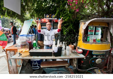 JAIPUR, INDIA - JAN 21: Bald bartender standing behind the weird retro style counter of street bar on January 21, 2015. Jaipur, with population 6,664000 people, is capital of Rajasthan - stock photo