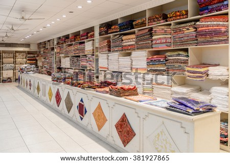 JAIPUR, INDIA - JAN 18, 2016: Interior of the Carpet and silk shop near Jaipur, India. Indian carpets and silk articles are popular for the tourists in India