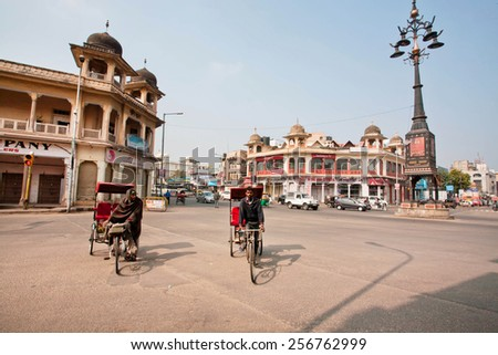 JAIPUR, INDIA - JAN 25: Two bike rickshaw compete in speed on the wide street on January 25, 2015. Jaipur, with population 6,664,000 people, is a capital of Rajasthan - stock photo