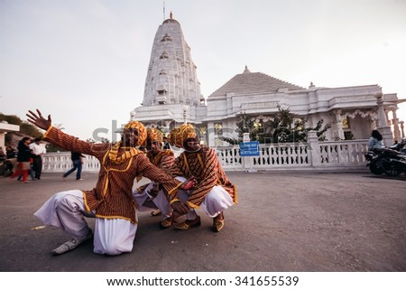 JAIPUR, INDIA - JANUARY 10, 2015: Indian dancers in national clothes near Birla Mandir temple (Laxmi Narayan) on January 10, 2015 in Jaipur, India - stock photo