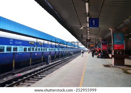 Jaipur, India - January 3, 2015: Passenger on platforms at the railway station of Jaipur, Rajasthan, India. Indian Railways carries about 7,500 million passengers annually. - stock photo