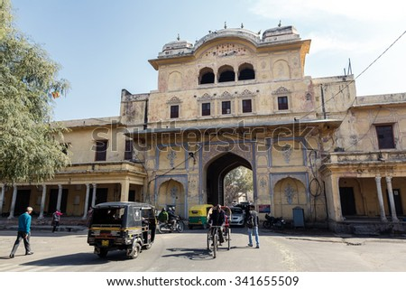 JAIPUR, INDIA - JANUARY 10, 2015: People and transport on the street on January 10, 2015 in Jaipur, India - stock photo