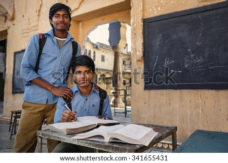 JAIPUR, INDIA - JANUARY 10, 2015: Two Indian male students with books on January 10, 2015 in Jaipur, India - stock photo