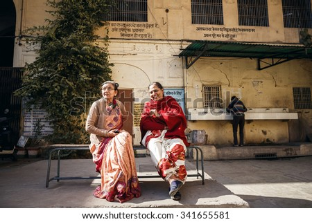 JAIPUR, INDIA - JANUARY 10, 2015: Two Indian mature women sitting on bench on January 10, 2015 in Jaipur, India - stock photo