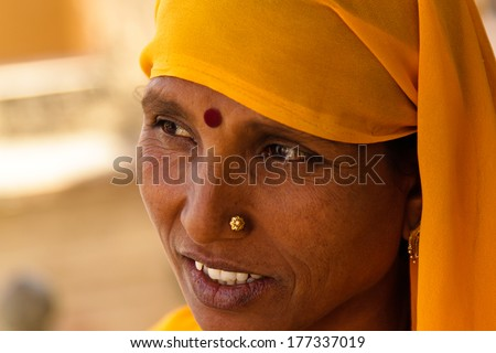 JAIPUR, INDIA � MARCH 3: An unidentified woman in Agra Fort on March 3, 2012 in Jaipur, Rajasthan, Northern India. Amber Fort overlooks Maota Lake and is 11km from Jaipur. - stock photo