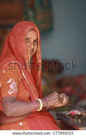 JAIPUR, INDIA � MARCH 4: An unidentified woman outside the City Palace on March 4, 2012 ahead of the annual Holi Festival in Jaipur, Rajasthan, Northern India.  - stock photo