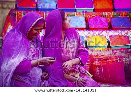 JAIPUR, INDIA - MARCH 17: Lady covered in paint on Holi festival, March 17, 2013, Jaipur, India. Holi, the festival of colors, marks the arrival of spring,  one of the biggest festivals in India - stock photo