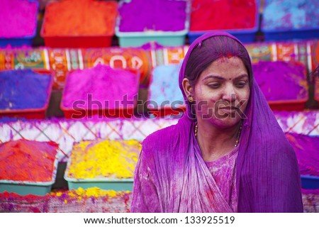 JAIPUR, INDIA - MARCH 17:Lady in violet, covered in paint on Holi festival, March 17, 2013, Jaipur, India. Holi, the festival of colors, the arrival of spring,  one of the biggest festivals in India - stock photo