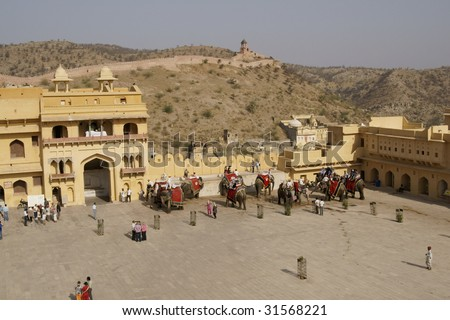 JAIPUR, INDIA - MARCH 10: Tourists mingle with elephants in the courtyard of Amber Fort on March 10, 2009 in Jaipur, India.