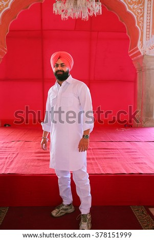 JAIPUR, INDIA - NOVEMBER 14: Unidentified man stands in City Palace on November 14, 2014  in Jaipur, India. Palace was the seat of the Maharaja of Jaipur, the head of the Kachwaha Rajput clan.