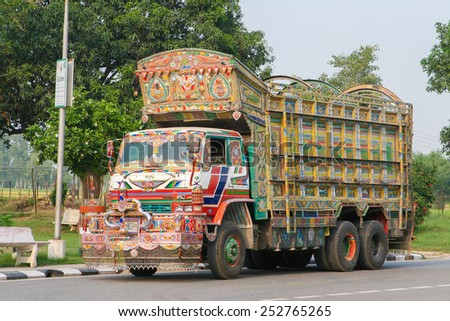 JAIPUR, INDIA - SEPTEMBER 27, 2008: Colorful Indian truck on a highway near Jaipur, Rajasthan, India - stock photo