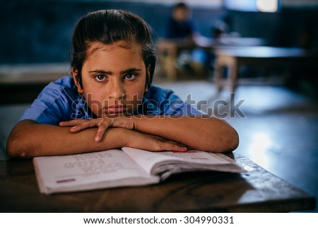 JAIPUR-MARCH 04 :child posing in the classroom  on March 04, 2014 in Jaipur,india - stock photo