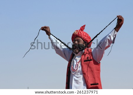 JAISALMER, INDIA - FEB 01: An unidentified  Rajasthani man participate in the  Mr. Mushtache contest conducted as part of Desert Festival held on February 01, 2015 in Jaisalmer, Rajasthan, India. - stock photo