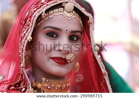 JAISALMER, INDIA - FEB 01: An unidentified Rajasthani woman participates in the Ms. Moomal contest conducted as part of Desert Festival held on February 01, 2015 in Jaisalmer, Rajasthan, India. - stock photo