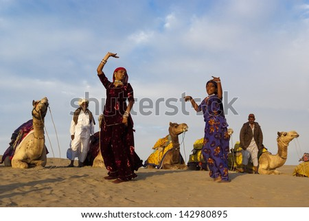 JAISALMER, INDIA-FEB 26: Cultural dance at Sam Sand Dune on Feb 26, 2013 in Jaisalmer, India.The event is part of the Desert Festival held in winter to attract both domestic and international tourists - stock photo