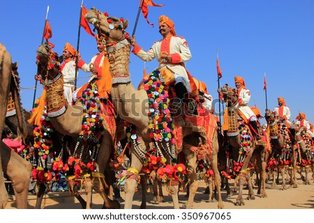 JAISALMER, INDIA - FEB 01:Traditionally dressed border security people sitting on camels attend a cultural procession for the Desert festival held on February 01, 2015 in Jaisalmer, Rajasthan, India. - stock photo