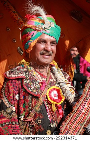 JAISALMER, INDIA - FEB 01: Unidentified Rajasthani villager with colorful traditional dress attends a cultural procession for Desert festival held on February 01, 2015 in Jaisalmer, Rajasthan, India. - stock photo