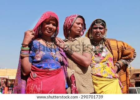 JAISALMER, INDIA - FEB 03: Unidentified tribal women dressed up in traditional Rajasthani costume and ornaments pose during Desert Festival on February 03, 2015 in Jaisalmer, Rajasthan, India. - stock photo