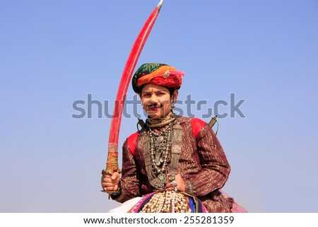 JAISALMER, INDIA - FEBRUARY 16: Unidentified boy takes part in Desert Festival on February 16, 2011 in Jaisalmer, India. Main purpose of this Festival is to display colorful culture of Rajasthan - stock photo