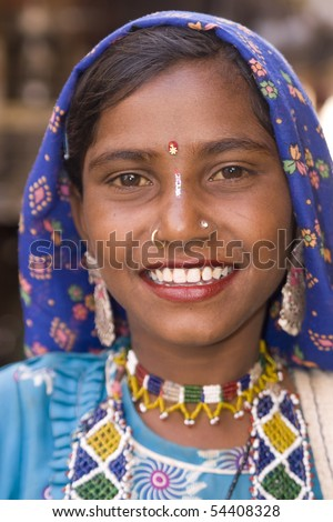 JAISALMER, INDIA - FEBRUARY 18: Unidentified Indian lady in traditional tribal outfit on February 18, 2008 in Jaisalmer Rajasthan, India. - stock photo