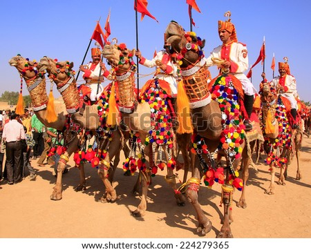 JAISALMER, INDIA - FEBRUARY 16: Unidentified men take part in Desert Festival on February 16, 2011 in Jaisalmer, India. Main purpose of Festival is to display rich and colorful culture of Rajasthan  - stock photo