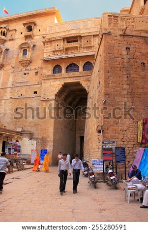 JAISALMER, INDIA - FEBRUARY 17: Unidentified people walk in Jaislamer fort on February 17, 2011 in Jaisalmer, India. Jaisalmer is called Golden City because of sandstone used in its architecture - stock photo