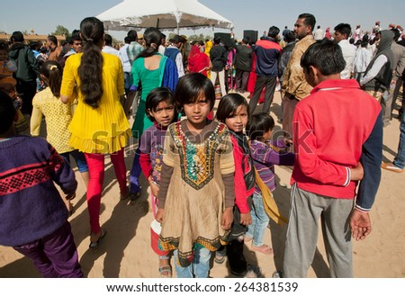 JAISALMER, INDIA - MAR 1: Unidentified children lost in the crowd of people during the popular annual Desert Festival on March 1, 2015. Every winter Jaisalmer takes the famous Desert Festival - stock photo