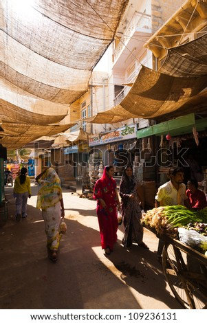 JAISALMER, INDIA - NOVEMBER 23: Indian people enter the bazaar, a daily stop for locals, at the base of the Jaislamer Fort on Noevember 23, 2009 in Jaisalmer, India - stock photo