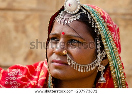 JAISALMER,INDIA - November 8,2014 : Unidentified Indian woman dressed her traditional scarfs with very nice ornaments and piercings in Jaisalmer,india. - stock photo