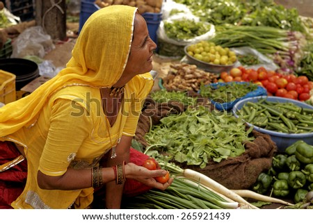 JAISALMER,INDIA - November 8,2014 : Unidentified woman grocer sells vegetables in the streets of Jaisalmer,india.