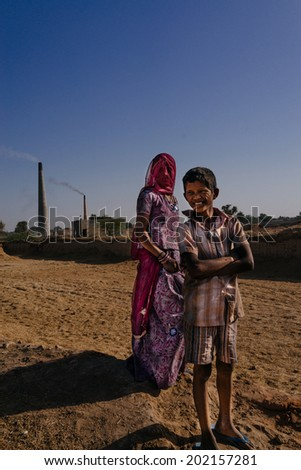 JAISALMER - MARCH 22 : unidentified people posing near brick factory on March 22 , 2014 in Jaisalmer,India