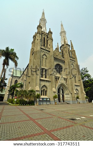 Jakarta cathedral with blue sky behind. Jakarta Cathedral is a Roman Catholic Cathedral in Jakarta, Indonesia and located in Central Jakarta.  - stock photo