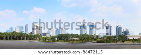 Jakarta city skyline view from National Monument (Monas) with blue sky - stock photo