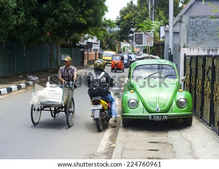 JAKARTA, INDONESIA - APRIL 03, 2012: Urban traffic on Jakarta street. Jakarta  with a population of almost 10 million people, it is the most populous city in Indonesia and in Southeast Asia - stock photo