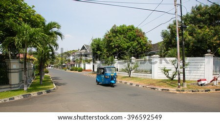 JAKARTA, INDONESIA - AUGUST 27, 2015: betjak is driving through Kayu Putih neighbourhood in Jakarta, Indonesia