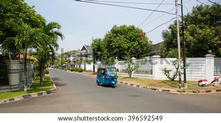 JAKARTA, INDONESIA - AUGUST 27, 2015: betjak is driving through Kayu Putih neighbourhood in Jakarta, Indonesia - stock photo