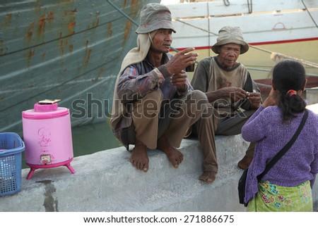 JAKARTA, INDONESIA - AUGUST 16, 2011: Stevedores dink tea in the historical port of Sunda Kelapa in Jakarta, Central Java, Indonesia. - stock photo