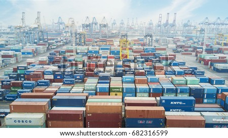 JAKARTA, Indonesia. July 10, 2017: Aerial view of many containers and cranes with container ship berthing at industrial port