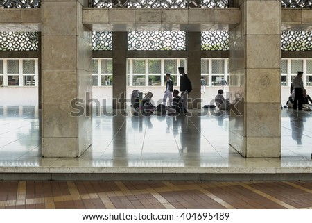 Jakarta, Indonesia - March 17, 2016:  Interior Istiqlal Mosque in Jakarta, Indonesia is the largest mosque in Southeast Asia.