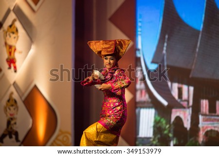 JAKARTA, INDONESIA: NOVEMBER 13, 2015: Dancers perform a traditional 'tarian pairing' from Sumatra at the opening ceremony of the 13th World Wushu Championship 2015 in Jakarta Convention Centre. - stock photo