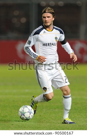 JAKARTA, INDONESIA. - NOVEMBER 30: L.A. Galaxy midfielder David Beckham (No. 23) during match Indonesian Team vs Los Angeles Galaxy at GBK Stadium on November 30, 2011 in Jakarta, Indonesia. - stock photo